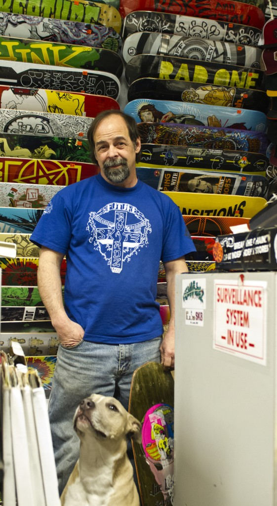 Future Sk8 owner, Don Earley stands in front of his board display with his dog Shasta. Early has built skateboarding from the bottom up, working for the major skate companies Splash, Santa Cruz, and Thrasher. In 1985 Earley opened his first shop, Future Sk8, only to expand and establish two more in surronding areas the following year. Earley closed in 1995 and then opened his current shop in 2010.